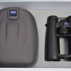 Black binocular and grey case in box